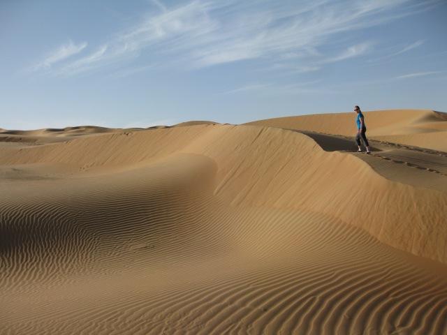 Becca trekking up the dunes