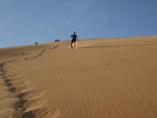 Dan running down the dune