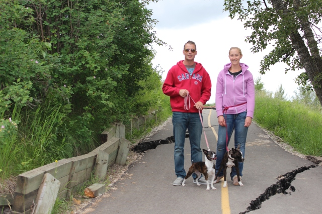 Dan and Paige with the dogs (flood damaged pathway near the Bow)