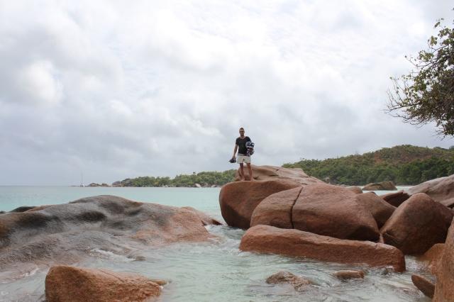 Dan on the rocks at Anse Lazio Beach