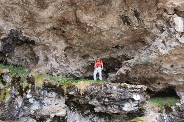 Dan in a cave near Moir Hut Camp