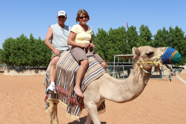 Judy and Vern taking a camel for a spin