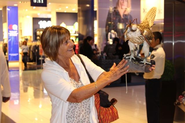 Mom with falcon in Dubai Mall