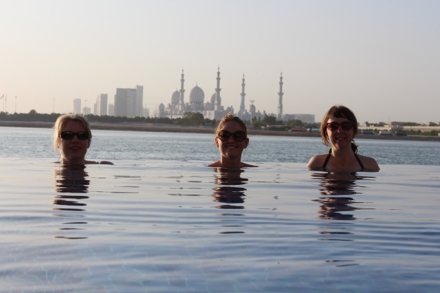 Girls relaxing in the infinity pool overlooking Sheikh Zayed Grand Mosque