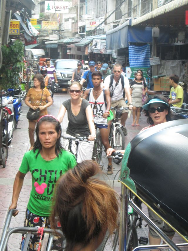 Dan and Becca biking through Bangkok's Chinatown