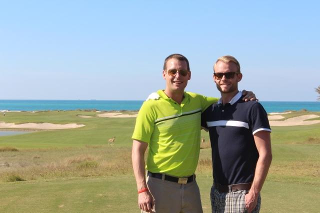 Dan and Scott on the tee box of Dolphin View at Saadiyat Beach Golf Club