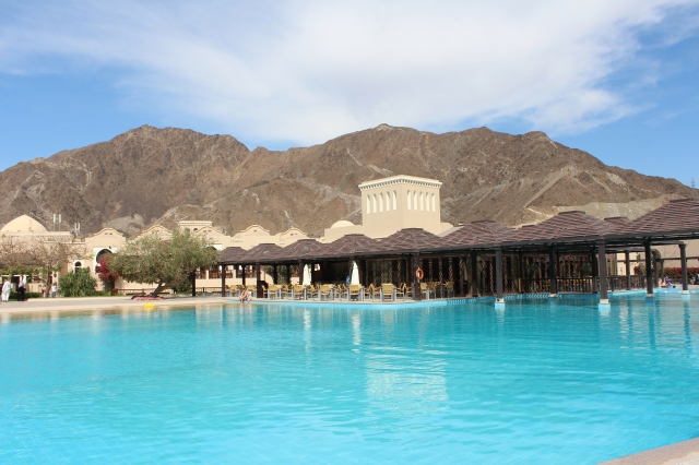 Miramar Hotel pool with Hajar Mountains behind
