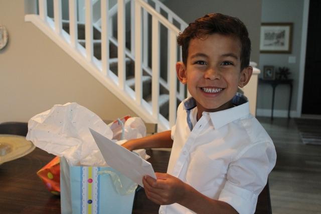 Wyatt making sure dad's birthday presents are in order