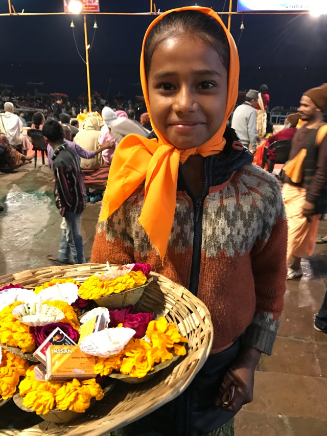 Little girl selling supplies for the puja